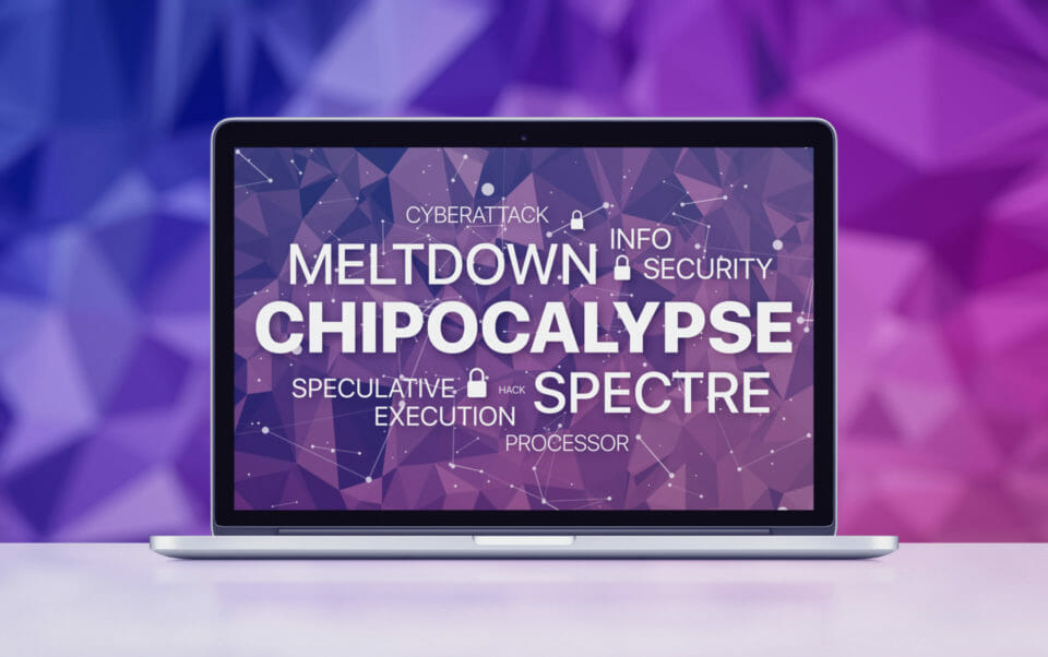 Meltdown and spectre threat concept on laptop screen on ultraviolet polygonal background